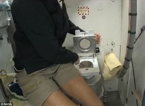 how astronauts go to the bathroom in space how do you use the toilet in zero gravity former iss