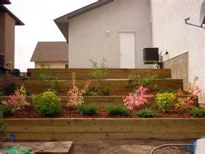 Using Landscape Timbers For Retaining Wall Here Build Wooden Retaining Wall Wood Design And Project