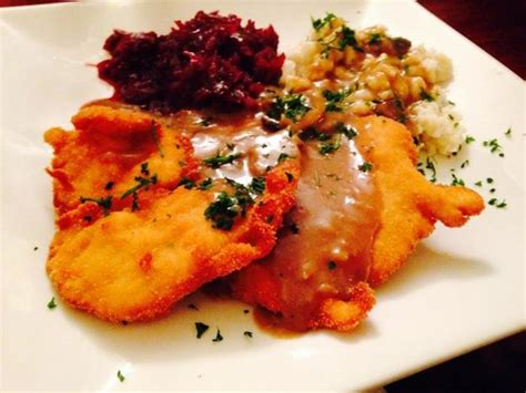 schnitzel with sauce cabbage and spaetzle