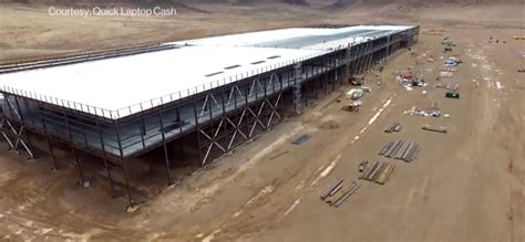 elon musk factory elon musk says planned gigafactory output could triple