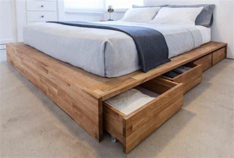Merveilleux Ikea Valet De Chambre #2: lit-tiroir-lit-avec-rangement-en-tiroirs-en-bois-sol-en-beton-linge-de-lit-bleu-clair.jpg