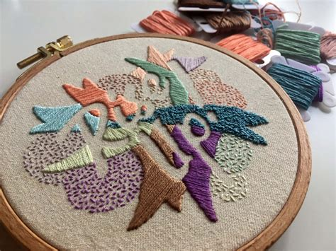 typography bursts through abstract embroidery scene360