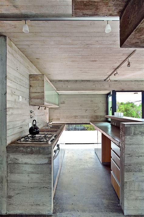 Concrete And Wood Kitchen by Modern House Ushers In Industrial Style With Concrete