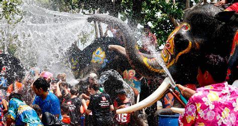 thai new year water festival thailand s songkran water festival begins amid regional