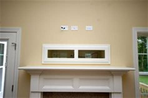before & after mantel: covering the tv niche above the