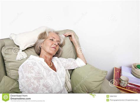 sleeping armchair tired senior woman sleeping on armchair at home stock