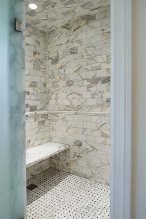 shower with calcutta gold marble transitional bathroom the wills company