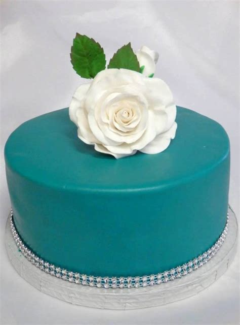 it is easy to have a cake that is both lovely to look at and oh so birthday cake turquoise color with some black to deepen it