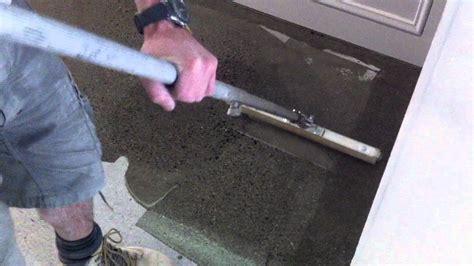 Rolling out polyurethane onto concrete flooring   YouTube