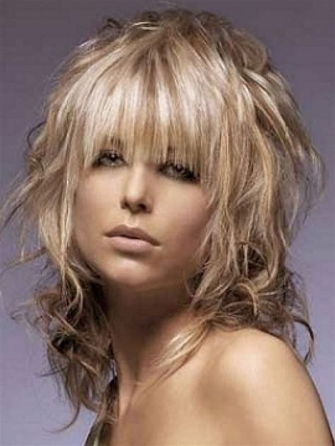 shag shaped feather styled cut the modern twist on the classic shag medium shaggy hairstyles with bangs hair pinterest