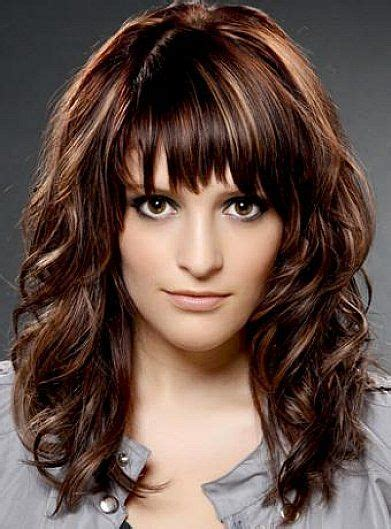 Pics Of Haircuts Medium Length Darker With Chunky Blonde Highlights | medium length hairstyles with bangs for thick wavy hair