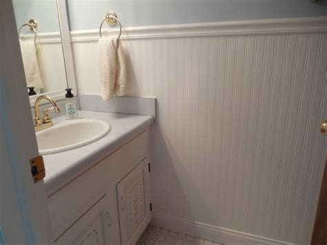 bathroom with chair rail should i continue floor tile up to chair rail height in