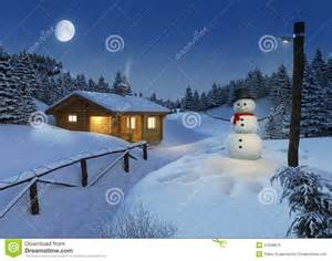 Cozy log cottage in a winter scene with snowman christmas lights and