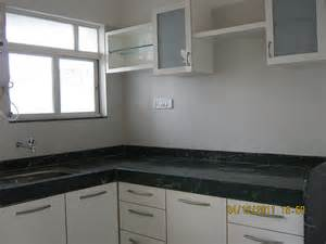 l shape marble kitchen platform with stainless steel sink