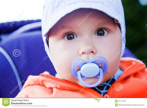 Boys Comforter Young Baby Boy With A Dummy In His Mouth Outdoors Stock