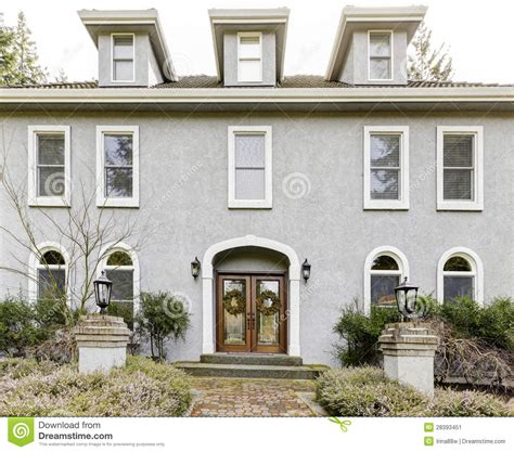 Bay Bow Windows home exterior of large grey classic house with many narrow