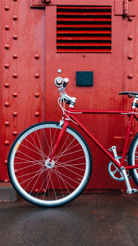 bicycle red wall wallpaper