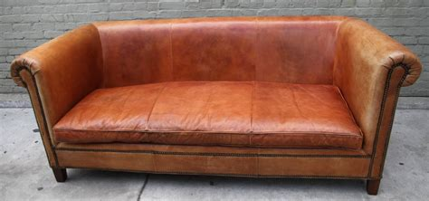 ralph lauren leather upholstered sofa w four pillows at