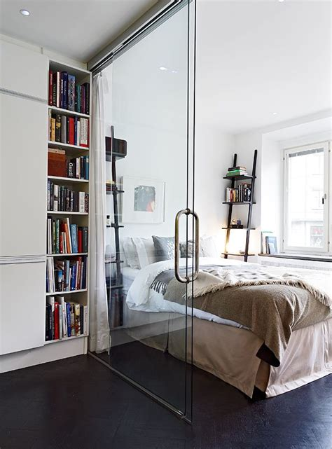 Glass Wall Room Divider Glass Wall Divider In A Small Apartment Separating Kitchen And Bedroom Small Space Solution