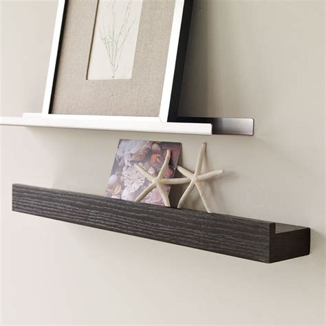 picture ledge ideas metal picture ledges displaying attractive decorations in