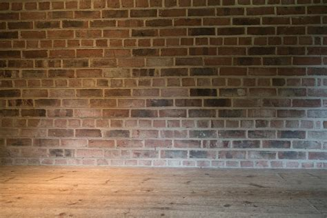 brick wall and wooden floor free stock photo