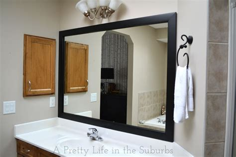 frame around bathroom mirror frame your mirror a pretty in the suburbs