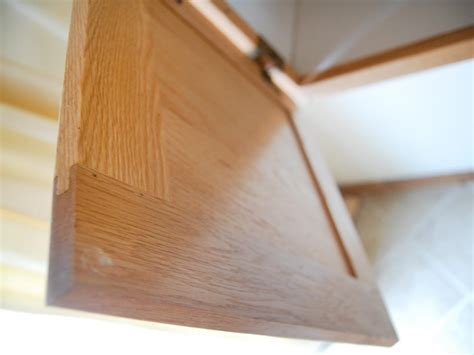 how to add glass inserts into your kitchen cabinets update kitchen cabinets with glass inserts hgtv