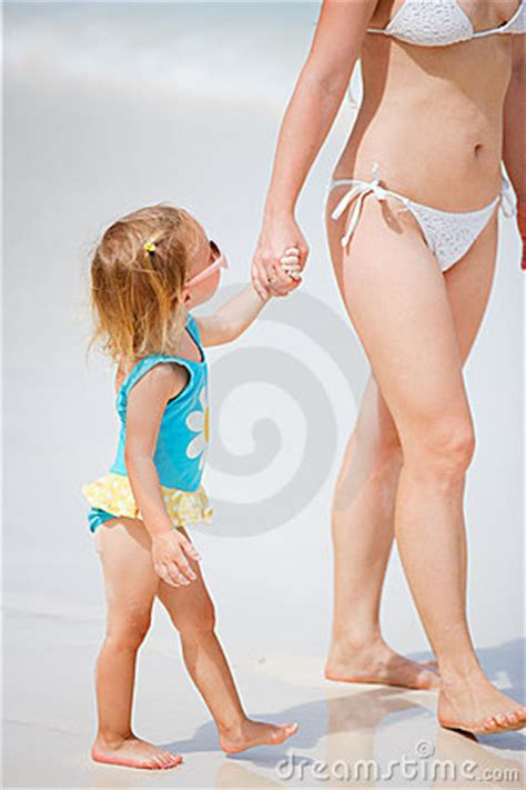 mother and daughter on beach vacation stock photos image