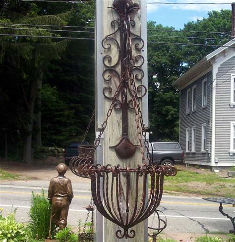 Wrought Iron Hanging Planters by Hanging Planter W Bracket Rust Finish Wrought Iron