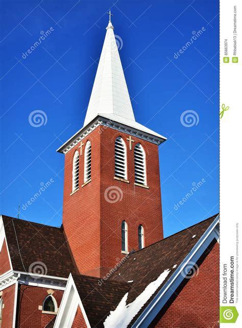 Superb Apex Churches #2: Brick-church-steeple-bright-blue-sky-85663974.jpg