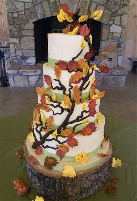 five tier white tree theme wedding cake with branches and leaves and tree trunk jpg
