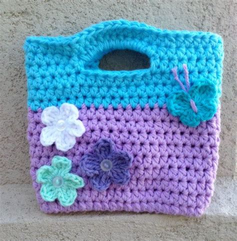 Blue Gypsea Crochet 1 this crochet purse in lavender and cupcake blue is the accessory for any