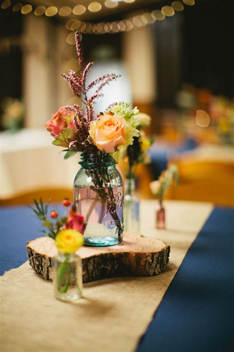 diy rustic fall wedding centerpieces the contrast of the warm fall florals with the cool blue of the jars was