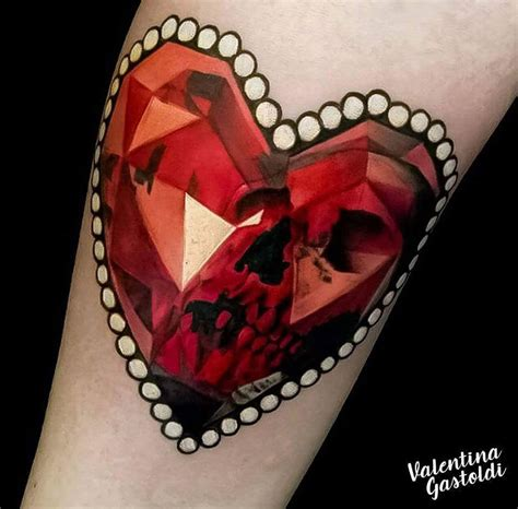 heart shaped ruby with skull best tattoo design ideas