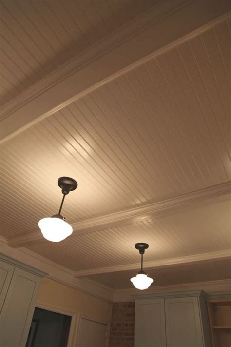 Update Popcorn Ceiling by Finished Beadboard Paneled Ceiling W Bronze Finished School House Pendant Fixtures In Kitchen