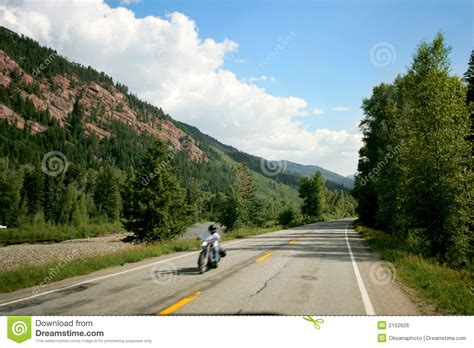 on road motocross motorcycle on a mountain road royalty free stock photo