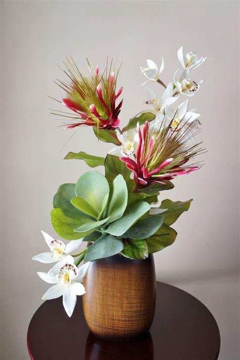 Vase Arrangements by 25 Best Ideas About Tropical Flower Arrangements On