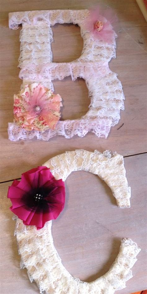 large wooden letters wrapped with lace ribbon and adorned