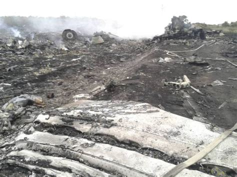 malaysia airlines mh 17 crash flight mh17 first pictures of malaysia airlines crash