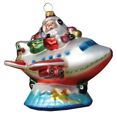 santa pilot on top of the world christmas tree aircraft