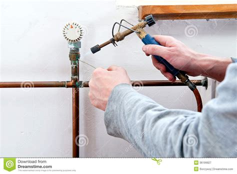 plumber soldering pipe royalty free stock photography