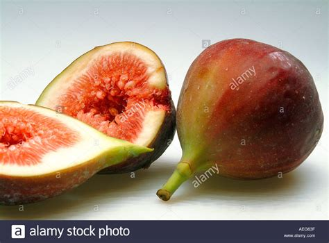 fruits vegetables fig figs cut open half stem fleshy food fruit stock photo royalty free image