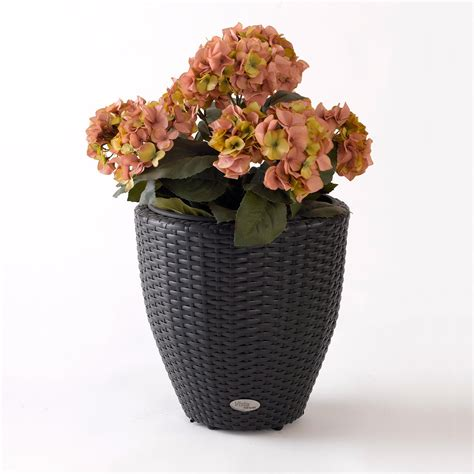 Resin Wicker Planters by Curved Resin Wicker Vista Planter Planters At