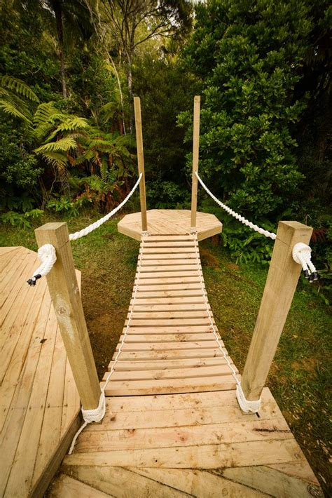 how to build a swinging bridge want to build a rope bridge in this video we show you how