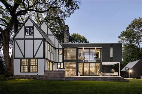modern tudor house renovation of a tudor style residence that is preserving