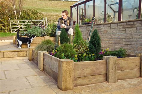 Laying Garden Sleepers by Woodstone Sleepers Marshalls Co Uk