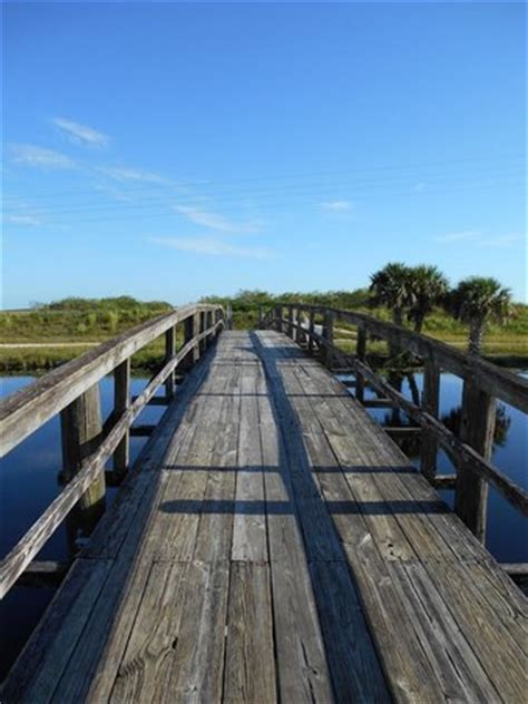 old wooden canal bridge across the highway picture of
