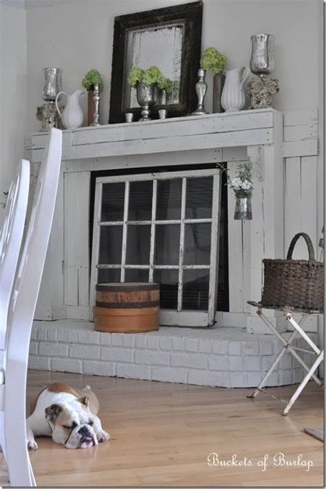 How To Cover A Fireplace Opening by I Don T Like The Fireplace Surround But The Vintage Window