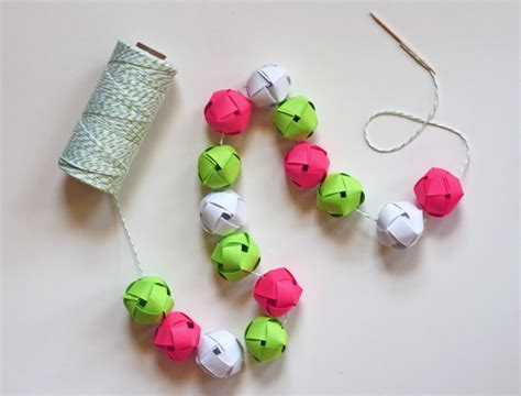 Make Paper Balls - make a garland from woven paper balls how about orange