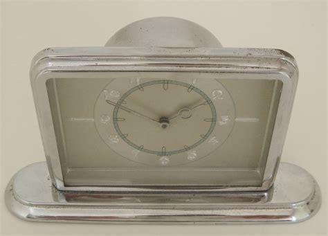 german deco small chrome desk clock with blue and